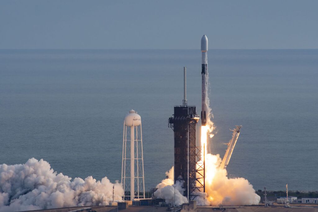 A Falcon 9 rocket lifts off carrying a classified payload for the NRO
